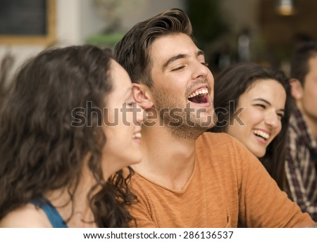 Multi-Ethnic Group of happy friends having fun at the restaurant - stock photo