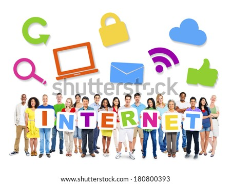 Multi-Ethnic Group Of People Holding Alphabet To Form Internet And Internet Themed Images Above - stock photo