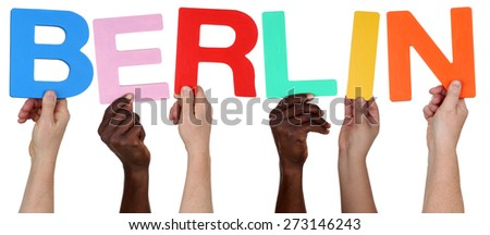 Multi ethnic group of people holding the word Berlin isolated - stock photo