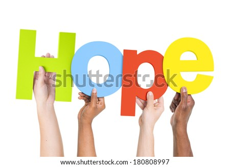 Multi-Ethnic Group Of People Holding The Word Hope - stock photo