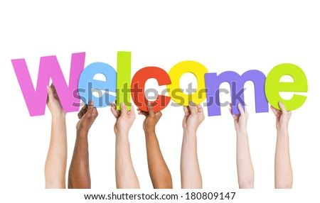 Multi-Ethnic Group Of People Holding The Word Welcome - stock photo
