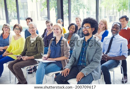 Multi-Ethnic Group of People in Seminar - stock photo