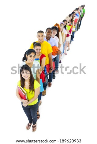Multi-ethnic group of student holding the book standing in line - stock photo