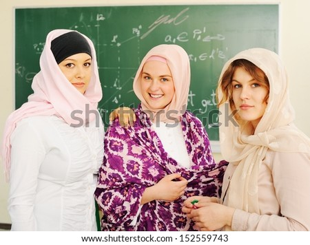 Multi ethnic group of teenage students inside the high school classroom posing on board - stock photo