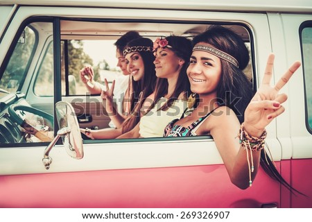 Multi-ethnic hippie friends on a road trip - stock photo
