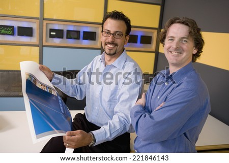 Multi-ethnic male graphic designers in office - stock photo