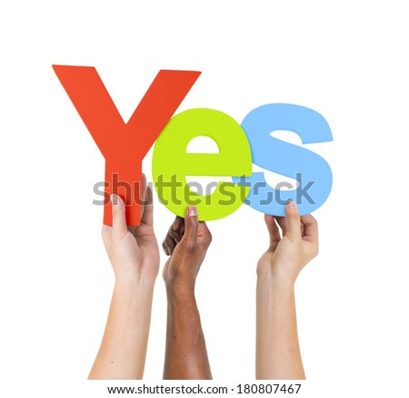 Multi Ethnic People Holding The Word Yes - stock photo
