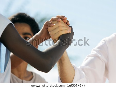 Multi-Ethnic people shaking hands, close up - stock photo