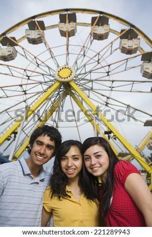 Multi-ethnic teenaged friends at carnival - stock photo