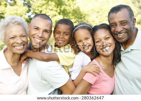 Multi Generation African American Family Relaxing In Park - stock photo