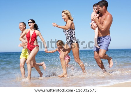 Multi Generation Family Enjoying Beach Holiday - stock photo