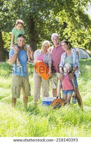 Multi-Generation Family Enjoying Camping In Countryside - stock photo