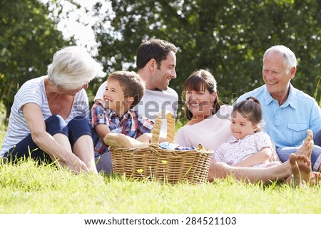 Multi Generation Family Enjoying Picnic In Countryside - stock photo