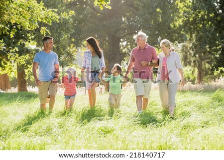 Multi-Generation Family Enjoying Walk In Beautiful Countryside - stock photo