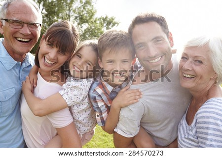 Multi Generation Family Giving Children Piggybacks Outdoors - stock photo