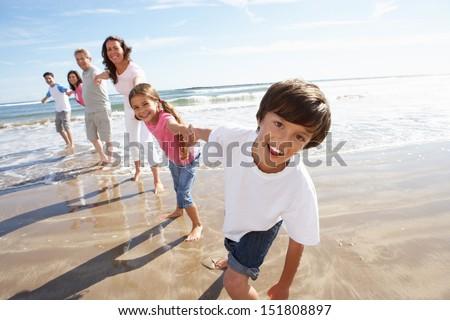 Multi Generation Family Having Fun On Beach Holiday - stock photo