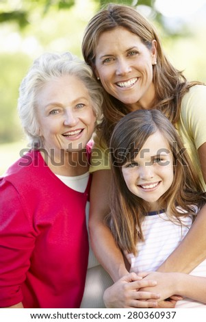Multi-generation family in park - stock photo