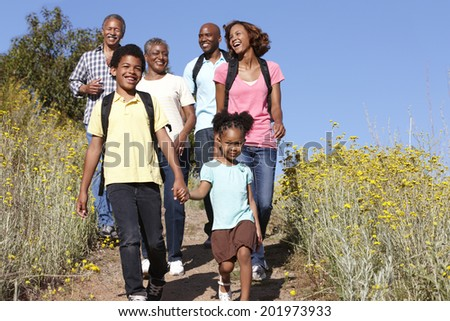 Multi-generation  family on country hike - stock photo
