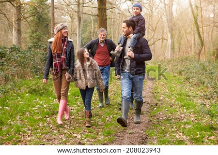 Multi Generation Family On Countryside Walk - stock photo