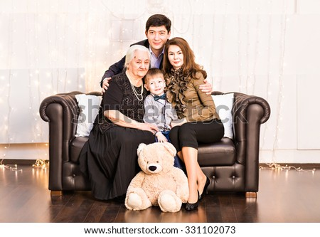 Multi Generation Family Relaxing On Sofa At Home - stock photo