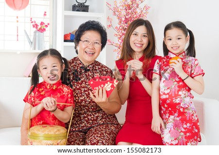 Multi generations Asian family celebrate Chinese new year at home. - stock photo