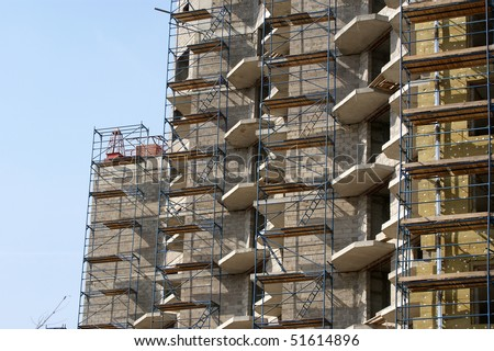 Multi-storey building under construction from concrete and metal - stock photo