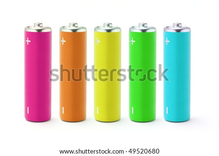 Multicolor AA size batteries on white background - stock photo