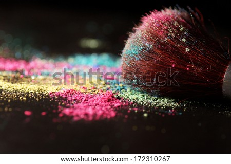 Multicolor crushed eyeshadow and brush - stock photo