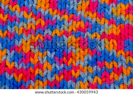 Multicolor front loops wool boucle yarn knitted fashion background - stock photo