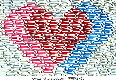 Multicolor paper clips arranged in hearts shape - stock photo