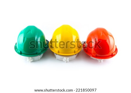multicolor safety, construction protection helmet isolated white background - stock photo