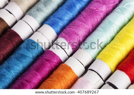 Multicolor sewing threads - stock photo