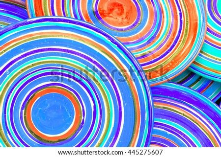 Multicolor striped plates, background. Toned - stock photo