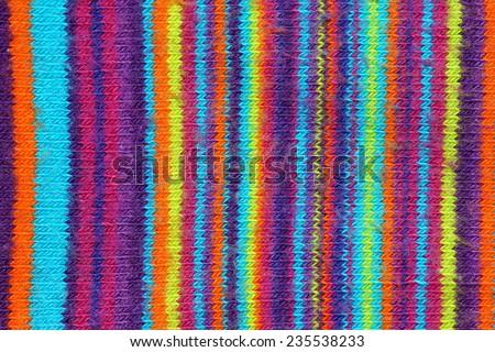 Multicolor stripes of woven cotton fabric background - stock photo