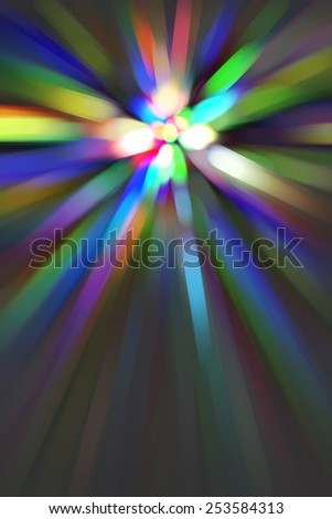 Multicolored abstract of many streaks with radial blur converging on a bright core, for themes of creation, transformation, and radiance - stock photo