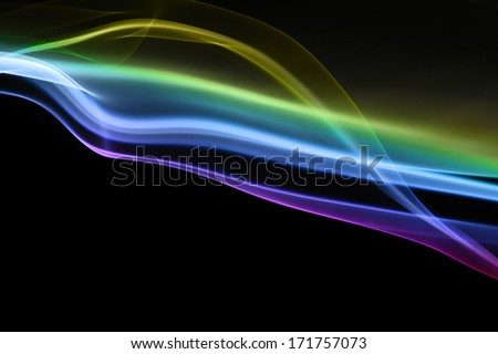 Multicolored abstract smoke on black background - macro photo - stock photo