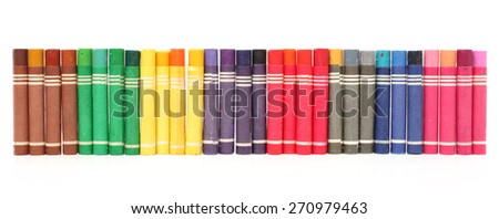 Multicolored background made of art tools - red, blue, brown,yellow, pink,orange pastel chalks - stock photo
