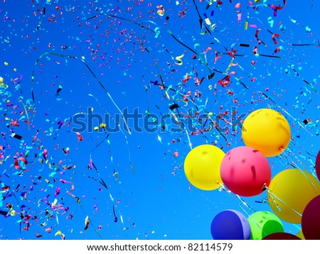 multicolored balloons and confetti in the city festival - stock photo