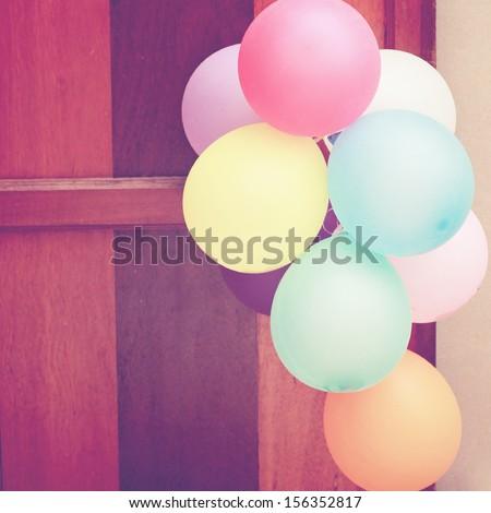 Multicolored balloons hanging on door - stock photo