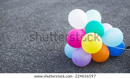 multicolored balloons on street ground - stock photo