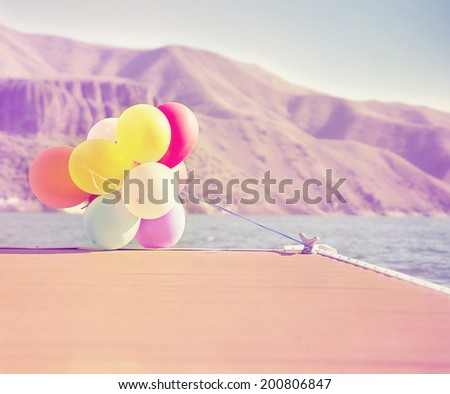 multicolored balloons with retro instagram filter effect  - stock photo