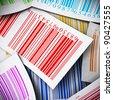 multicolored bar codes background square image - stock photo