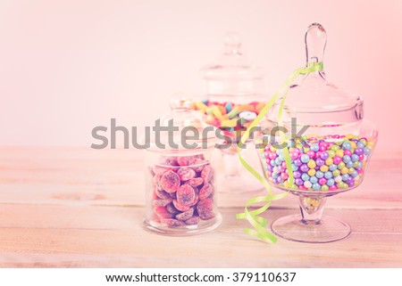 Multicolored candies in glass candy jars. - stock photo
