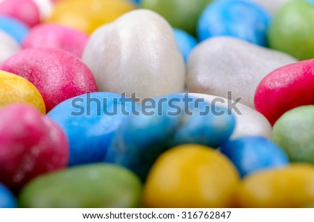 Multicolored candy sweet beans. Closeup with shallow DOF. - stock photo