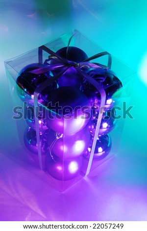Multicolored Christmas baubles in a gift box