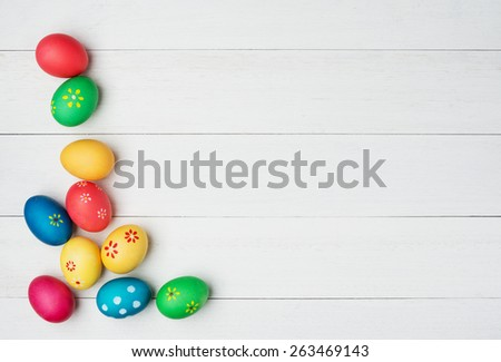 multicolored easter eggs on vintage painted wooden background - stock photo