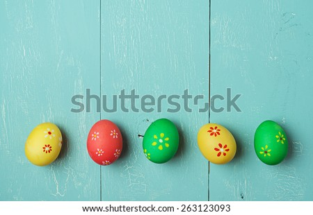 multicolored easter eggs on vintage painted wooden background with craquelure - stock photo