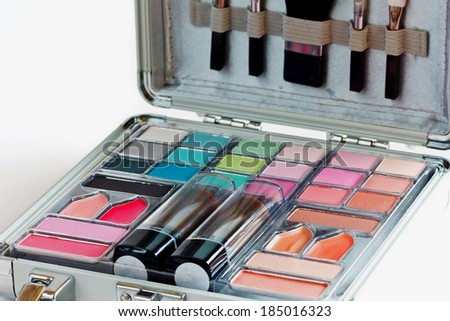 Multicolored eye shadows with cosmetics brush. Eyeshadow makeup palette. Colorful eye shadow make up. - stock photo
