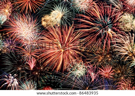 Multicolored fireworks fill the horizontal frame - stock photo