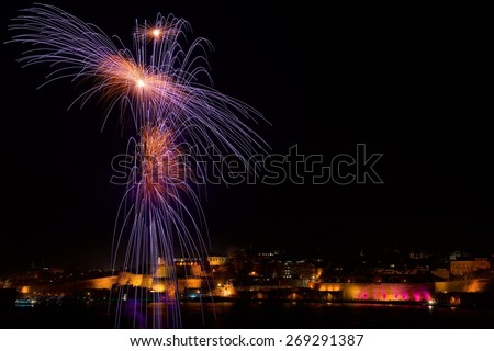 Multicolored fireworks in Valletta isolated in dark background with the place for text, Malta fireworks festival, 4 of July, Independence day, New Year, explode, fireworks in Malta - stock photo